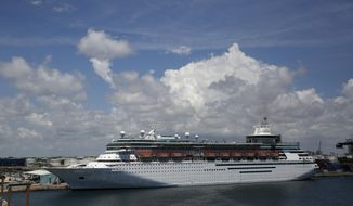 A Royal Caribbean Cruise ship called the Majesty of the Seas sets out at Port Everglades and will no longer go to Cuba, on Wednesday, June 5, 2019, in Fort Lauderdale, Fla. The Trump administration on Tuesday imposed major new travel restrictions on visits to Cuba by U.S. citizens, including a ban on many forms of educational and recreational travel. (AP Photo/Brynn Anderson)