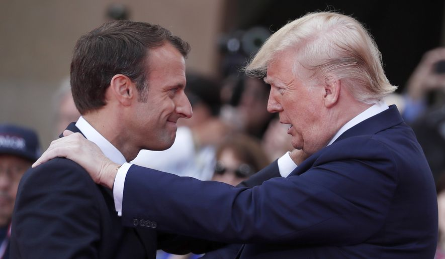 French President Emmanuel Macron, left, meets U.S President Donald Trump during a ceremony to mark the 75th anniversary of D-Day at the Normandy American Cemetery in Colleville-sur-Mer, Normandy, France, Thursday, June 6, 2019. World leaders are gathered Thursday in France to mark the 75th anniversary of the D-Day landings. (Ian Langsdon/POOL via AP)