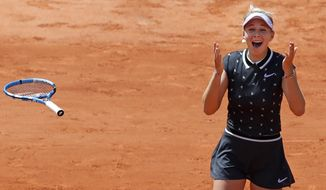 Amanda Anisimova of the U.S. celebrates winning her quarterfinal match of the French Open tennis tournament against Romania's Simona Halep in two sets, 6-2, 6-4, at the Roland Garros stadium in Paris, Thursday, June 6, 2019. (AP Photo/Christophe Ena)