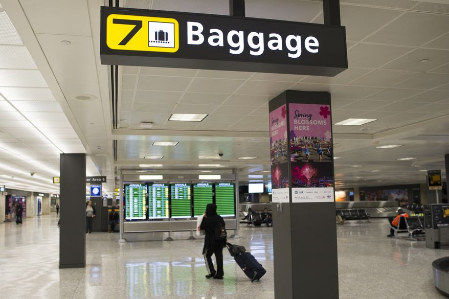 A baggage claim area at Dulles International Airport in Dulles, Va., Tuesday, March 26, 2019. (AP Photo/Cliff Owen)