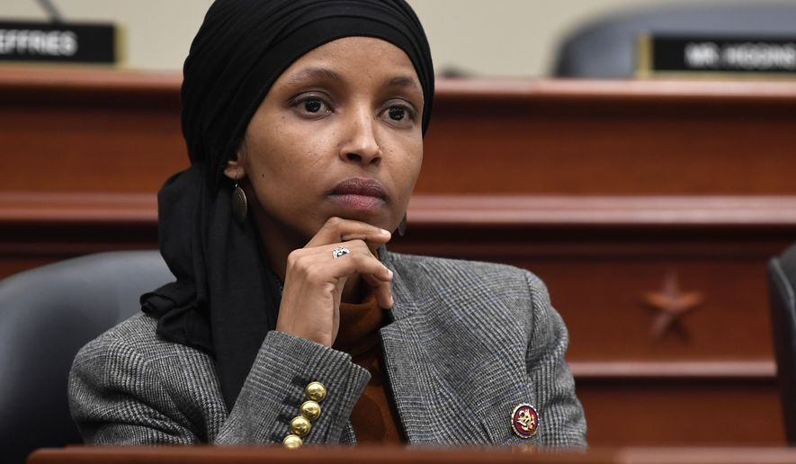 This March 12, 2019, file photo shows Rep. Ilhan Omar, D-Minn., listening as Office of Management and Budget Acting Director Russell Vought testifies before the House Budget Committee on Capitol Hill in Washington. A Minnesota campaign finance board says Omar violated state rules when she used campaign funds to pay for personal out-of-state travel and help on her tax returns. The Minnesota Campaign Finance and Public Disclosure Board said Thursday, June 6, 2019,  that Omar must reimburse her former campaign committee nearly $3,500. The first-term Democratic congresswoman also must pay the state a $500 civil penalty for using campaign money to travel to Florida, where she accepted an honorarium. (AP Photo/Susan Walsh, File)