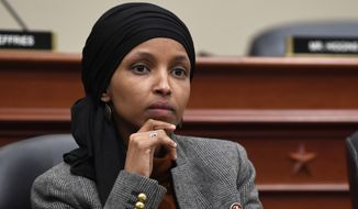 This March 12, 2019, file photo shows Rep. Ilhan Omar, D-Minn., listening as Office of Management and Budget Acting Director Russell Vought testifies before the House Budget Committee on Capitol Hill in Washington. (AP Photo/Susan Walsh, File)