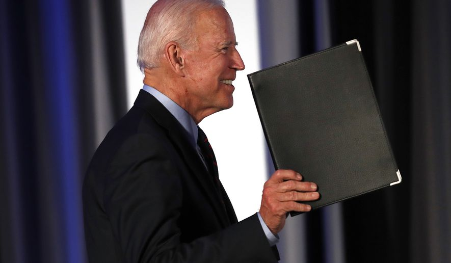 Democratic presidential candidate former Vice President Joe Biden gestures as he steps on stage before speaking during the I Will Vote Fundraising Gala Thursday, June 6, 2019, in Atlanta. (AP Photo/John Bazemore)