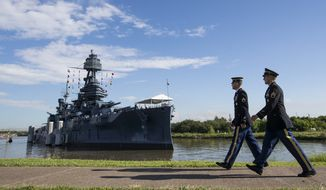 Army Staff Sgt. Jacob Klein, left, and Staff Sgt. Joel Ocasio arrive to the Battleship Texas to participate in a ceremony commemorating the 75th anniversary of D-Day on Thursday, June 6, 2019, in La Porte, Texas. The U.S.S. Texas was part of the D-Day operations in Normandy and is the last remaining battleship to have served during the invasion. (Brett Coomer/Houston Chronicle via AP)