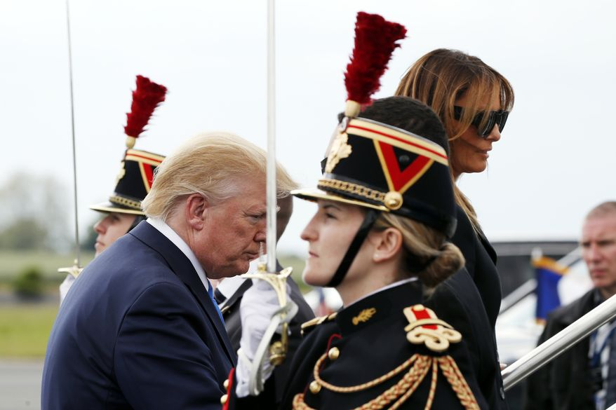 President Donald Trump and first lady Melania Trump board Air Force One on their departure at Caen Airport, Thursday, June 6, 2019, in Caen, France. (AP Photo/Alex Brandon)