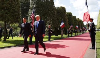 President Donald Trump and French President Emmanuel Macron, arrive to a ceremony to commemorate the 75th anniversary of D-Day at The Normandy American Cemetery, Thursday, June 6, 2019, in Colleville-sur-Mer, Normandy, France. (AP Photo/Alex Brandon)