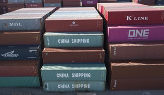 In this May 10, 2019, file photo China Shipping Co. containers are stacked at the Virginia International's terminal in Portsmouth, Va. Over the past month, President Donald Trump has rolled the dice on the economy. He has more than doubled tariffs on $200 billion in Chinese imports. The president is preparing to target another $300 billion, extending his import taxes to everything China ships to the United States. (AP Photo/Steve Helber, File)