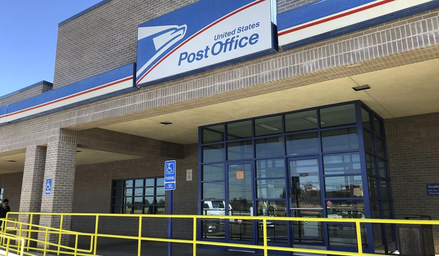 This June 6, 2019, image shows the Academy Station Post Office in Albuquerque, N.M. It was one of 13 postal facilities in Albuquerque found to have deficiencies as part of an audit requested by members of the state's congressional delegation. (AP Photo/Susan Montoya Bryan)