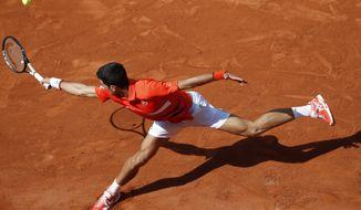 Serbia's Novak Djokovic plays a shot against Germany's Alexander Zverev during their quarterfinal match of the French Open tennis tournament at the Roland Garros stadium in Paris, Thursday, June 6, 2019. (AP Photo/Christophe Ena)