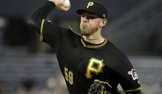 Pittsburgh Pirates starting pitcher Joe Musgrove delivers during the second inning of the team's baseball game against the Atlanta Braves in Pittsburgh, Wednesday, June 5, 2019. (AP Photo/Gene J. Puskar)