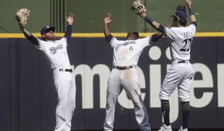 Milwaukee Brewers' Ben Gamel, Lorenzo Cain and Christian Yelich celebrate after a baseball game against the Miami Marlins Thursday, June 6, 2019, in Milwaukee. The Brewers won 5-1. (AP Photo/Morry Gash)