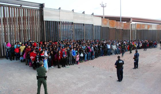This May 29, 2019, photo released by U.S. Customs and Border Protection (CBP) shows some of 1,036 migrants who crossed the U.S.-Mexico border in El Paso, Texas, the largest that the Border Patrol says it has ever encountered. The federal government is opening a new mass shelter for migrant children near the U.S-Mexico border and is considering housing children on three military bases to add 3,000 more beds to the overtaxed system in the coming weeks. (U.S. Customs and Border Protection via AP) **FILE**