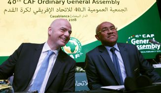 FILE - In this Feb. 2, 2018 file photo, Confederation of African Football president Ahmad Ahmad of Madagascar, right, and FIFA president Gianni Infantino attend the opening of the Confederation of African Football general assembly in Casablanca, Morocco. FIFA vice president Ahmad was detained by French authorities on Thursday June 6, 2019 in the latest criminal investigation to hit soccer's governing body. (AP Photo/Abdeljalil Bounhar, File)