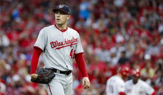 Washington Nationals starting pitcher Patrick Corbin walks to the dugout after being relieved in the fourth inning of a baseball game against the Cincinnati Reds, Friday, May 31, 2019, in Cincinnati. (AP Photo/John Minchillo) ** FILE **