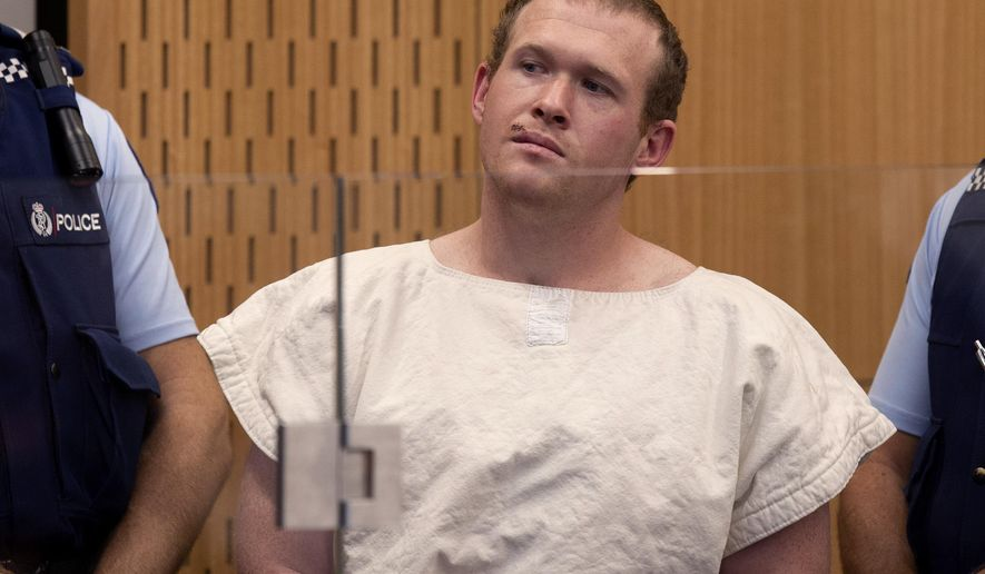 In this Saturday, March 16, 2019 photo, Brenton Tarrant, the man charged in the Christchurch mosque shootings, appears in the Christchurch District Court, in Christchurch, New Zealand. (AP Photo/Mark Mitchell, Pool)
