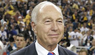 FILE - In this Feb. 5, 2006, file photo, former Green Bay Packers' Bart Starr carries in the Vince Lombardi Trophy following the Super Bowl XL football game between the Seattle Seahawks and Pittsburgh Steelers, in Detroit. The Steelers won, 21-10. Bart Starr, the Green Bay Packers quarterback and catalyst of Vince Lombardi's powerhouse teams of the 1960s, has died. He was 85. The Packers announced Sunday, May 26, 2019, that Starr had died, citing his family. He had been in failing health since suffering a serious stroke in 2014. (AP Photo/Michael Conroy, File)