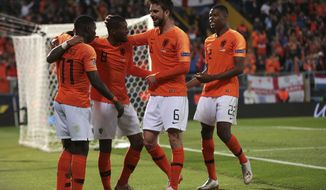 Netherlands' Quincy Promes, left, celebrates with teammates after scoring his side's third goal during the UEFA Nations League semifinal soccer match between Netherlands and England at the D. Afonso Henriques stadium in Guimaraes, Portugal, Thursday, June 6, 2019. (AP Photo/Luis Vieira)