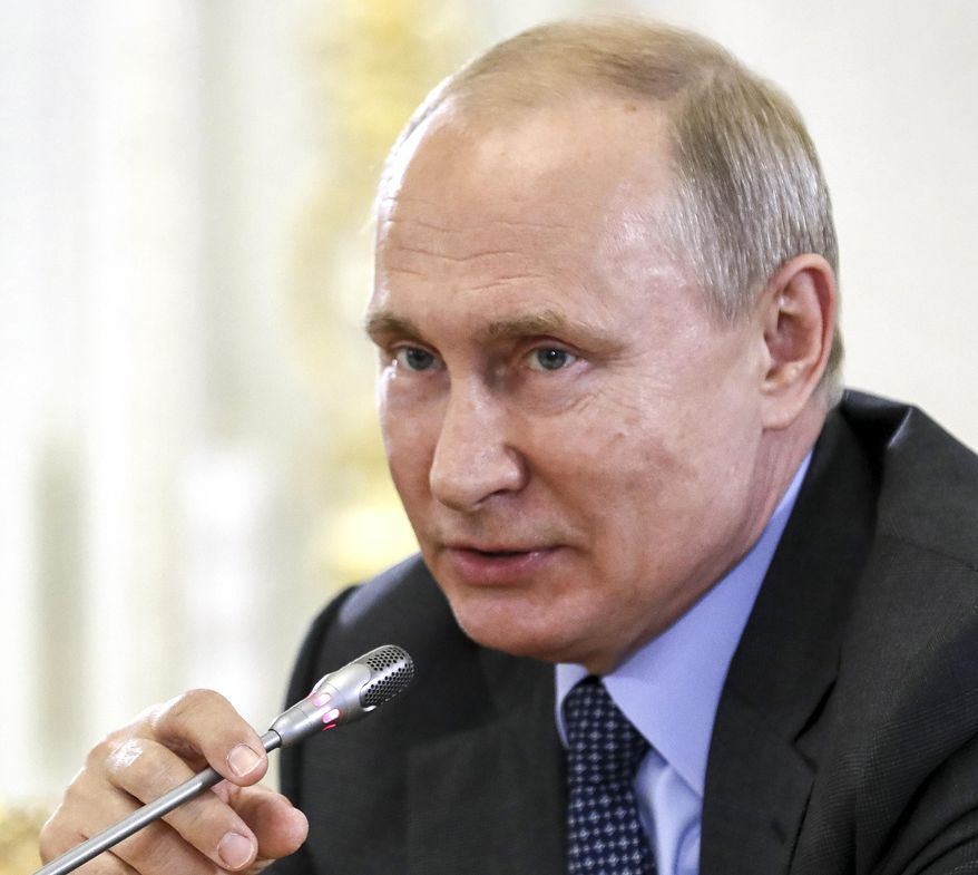 Russian President Vladimir Putin speaks during a meeting with heads of world's leading news agencies at the St. Petersburg International Economic Forum in St. Petersburg, Russia, Thursday, June 6, 2019. Putin has told reporters that Moscow has no intention to deploy its troops or set up military bases in Venezuela. (Yuri Kochetkov/Pool Photo via AP)