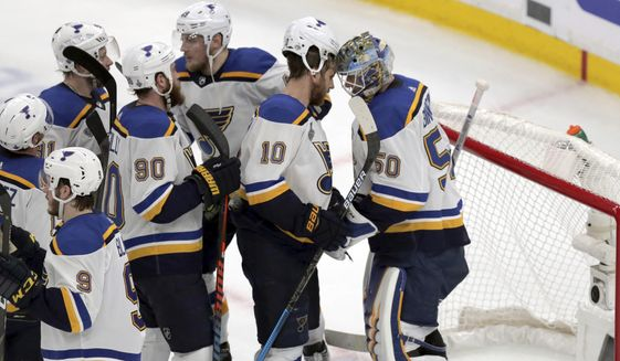 St. Louis Blues teammates congratulate goaltender Jordan Binnington, right, after defeating the Boston Bruins in Game 5 of the NHL hockey Stanley Cup Final, Thursday, June 6, 2019, in Boston. (AP Photo/Charles Krupa) **FILE**