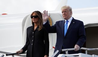President Donald Trump, with first lady Melania Trump, arrive at Caen Airport, Thursday, June 6, 2019, in Caen, France. (AP Photo/Alex Brandon)