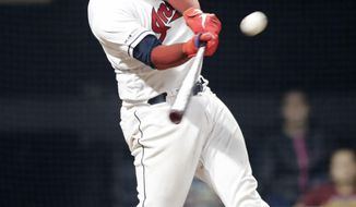 Cleveland Indians' Roberto Perez hits a solo home run off Minnesota Twins relief pitcher Blake Parker during the seventh inning of a baseball game Wednesday, June 5, 2019, in Cleveland. (AP Photo/Tony Dejak)