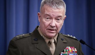 """FILE - In this April1 14, 2018, file photo, then-Marine Lt. Gen. Kenneth """"Frank"""" McKenzie speaks during a media availability at the Pentagon in Washington. McKenzie, the top commander of U.S. forces in the Mideast says Iran appears to have decided to """"step back and recalculate"""" in response to a U.S. military buildup in the Persian Gulf area. (AP Photo/Alex Brandon, File)"""