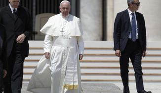 Pope Francis leaves at the end of his weekly general audience in St. Peter square at the Vatican, Wednesday, June 5, 2019. At left is Francis' butler Sandro Mariotti. (AP Photo/Andrew Medichini)