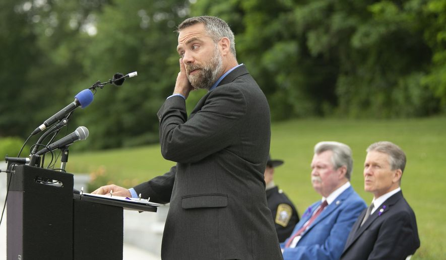 Jason Towery, Stafford County, Va., director of Public Works, speaks during a memorial service for Christopher K. Rapp and the victims of the Virginia Beach shootings Wednesday, June 5, 2019, in Stafford, Va. Rapp, a former Stafford County, Va., employee who was one of 12 killed in the May 31, shooting at the Virginia Beach Municipal Center in Virginia Beach, Va. (Mike Morones/The Free Lance-Star via AP)