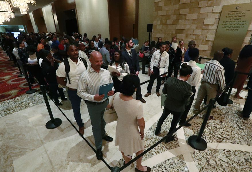 In this Tuesday, June 4, 2019, photo, job applicants line up at the Seminole Hard Rock Hotel & Casino Hollywood during a job fair in Hollywood, Fla. (AP Photo/Wilfredo Lee)