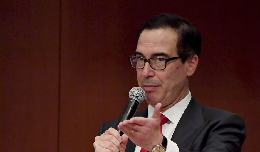 U.S. Treasury Secretary Steven Mnuchin delivers a speech during the G-20 Ministerial Symposium on International Taxation in the G-20 Finance Ministers and Central Bank Governors meeting in Fukuoka, southern Japan, Saturday, June 8, 2019. Finance chiefs of the Group of 20 major economies meeting in the Japanese city of Fukuoka are debating how to revise tax systems to ensure big companies pay their fair share and support economies as global growth slows. (Toshifumi Kitamura/Pool Photo via AP)