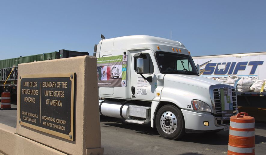 "In this Oct. 21, 2011, file photo, a truck crosses the border between Mexico and the United States in Nuevo Laredo, Mexico. President Donald Trump says he has ""indefinitely suspended"" tariffs he has threatened to impose Monday on Mexican imports. Trump says on Twitter that the U.S. and Mexico ""reached a signed agreement"" Friday, June 7, 2019 night. The president says Mexico ""has agreed to take strong measures to stem the tide of Migration through Mexico, and to our Southern Border."" (AP Photo/Hans-Maximo Musielik, File) **FILE**"