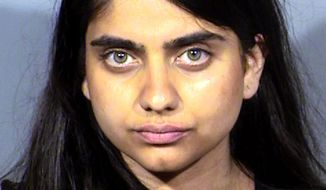This Thursday, June 6, 2019, mug photo released by the Clark County Detention Center photo shows Priya Sawhney, 30, of Berkley, Calif., following her arrest Thursday, June 6, in Las Vegas on a misdemeanor trespassing charge. Authorities say she was arrested after approaching Amazon CEO and founder Jeff Bezos on stage at a conference at the Aria resort and yelling about chicken farms. The group Direct Action Everywhere publicized Sawhney's protest. Las Vegas police say Sawhney may face additional charges. (Las Vegas Metropolitan Police Department via AP)