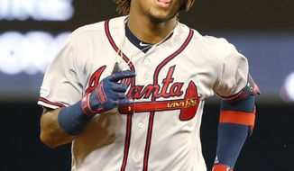 Atlanta Braves' Ronald Acuna Jr. blows a bubble as he rounds second base after hitting a home run during the fourth inning of a baseball game against the Miami Marlins, Friday, June 7, 2019, in Miami. (AP Photo/Wilfredo Lee)