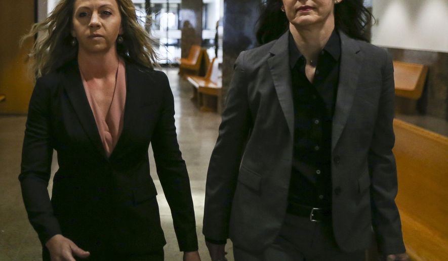 Former Dallas police Officer Amber Guyger, left, walks the hallway at the Frank Crowley Courts Building in Dallas on Thursday, June 6, 2019. Guyger is charged with murder in the Sept. 6 shooting death of Botham Jean in his own apartment. (Ryan Michalesko/The Dallas Morning News via AP)