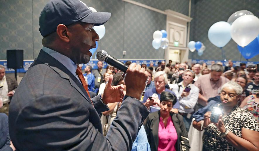 Former Florida Democratic gubernatorial nominee Andrew Gillum speaks to supporters during a gathering at the Florida Democratic Party state conference, Friday, June 7, 2019, in Orlando, Fla. (AP Photo/John Raoux)