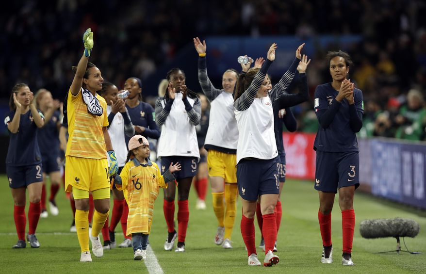 France players celebrate at the end of the Women's World Cup Group A soccer match between France and South Korea at the Parc des Princes in Paris, Friday, June 7, 2019. France won 4-0. (AP Photo/Alessandra Tarantino)