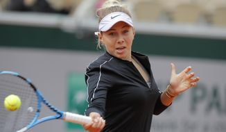 Amanda Anisimova of the U.S. plays a shot against Australia's Ashleigh Barty during their semifinal match of the French Open tennis tournament at the Roland Garros stadium in Paris, Friday, June 7, 2019. (AP Photo/Michel Euler)