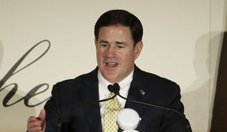 File - In this March 19, 2019, file photo, Arizona Gov. Doug Ducey speaks at a luncheon in Phoenix. Gov. Ducey is expected to act on a bill Friday, June 7, 2019, pushed by the Arizona Chamber of Commerce and Industry adding new requirements for citizen initiative petition circulators. (AP Photo/Ross D. Franklin)