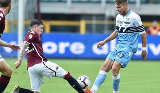 Torino's Daniele Baselli and Lazio's Ciro Immobile, right, go for the ball during the Serie A soccer match between Torino and Lazio at Olympic stadium in Turin, Italy, Sunday, May 26, 2019. (Alessandro Di Marco/ANSA via AP)