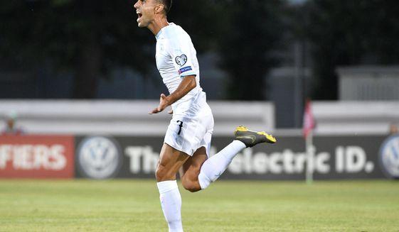 Israel's Eran Zahavi celebrates after he scored goal during their Euro 2020 group G qualifying soccer match between Latvia and Israel in Riga, Latvia, Friday, June 7, 2019. (AP Photo/Roman Koksarov)
