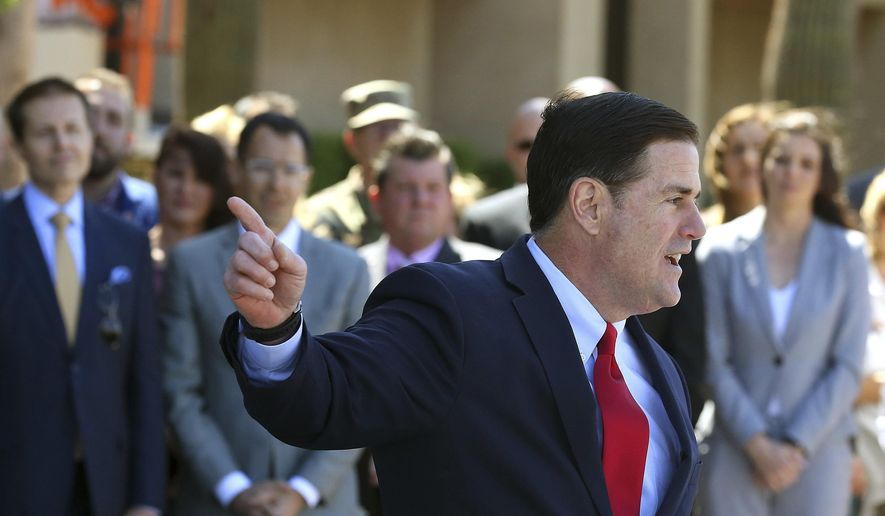 In this April 10, 2019, file photo, Republican Arizona Gov. Doug Ducey speaks at the Arizona Capitol in Phoenix.  (AP Photo/Ross D. Franklin, File) **FILE**