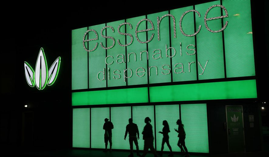 FILE - This April 16, 2018, file photo shows the Essence cannabis dispensary in Las Vegas. Nevada's governor has signed a law Wednesday, June 5, 2019, allowing the state to test out a voluntary, marijuana banking system for three years. (AP Photo/John Locher, File)