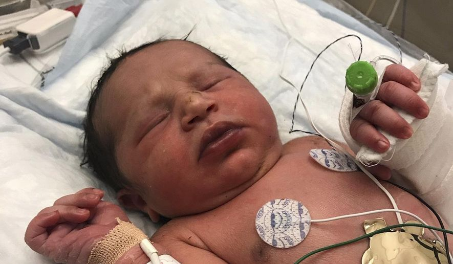 This photo released by the Forsyth County Sheriff's Office shows a newborn baby girl found alive in a plastic bag in a wooded area in Cumming, Ga., by Forsyth County deputies Thursday, June 6, 2019. She was taken to a hospital and is listed in stable condition. (Forsyth County Sheriff's Office via AP) **FILE**