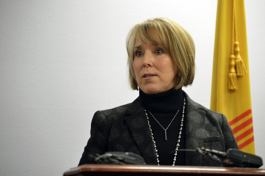 In this Jan 7, 2019, file photo, New Mexico Gov. Michelle Lujan Grisham speaks at a news conference in Albuquerque, N.M. Lujan Grisham is opposed to plans by a New Jersey-based company to build a multibillion-dollar facility in her state to temporarily store spent nuclear fuel from commercial reactors around the United States. Gov. Grisham sent a letter Friday, June 7, 2019, to U.S. Energy Secretary Rick Perry, saying the interim storage of high-level waste poses significant and unacceptable risks to residents, the environment and the region's economy. (AP Photo/Russell Contreras, File)