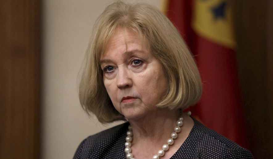 """In this Sept. 19, 2017 file photo St. Louis Mayor Lyda Krewson holds a news conference at city hall in St. Louis. St. Louis has pulled several police officers off the street while an internal investigation continues after they were accused of posting objectionable Facebook messages, Mayor Krewson said Friday, June 7, 2019. The decision to place the officers on administrative duty follows publication of a database that appears to catalog thousands of bigoted or violent posts by active-duty and former officers in St. Louis and elsewhere. Police departments in at least five states are investigating. Krewson, in an interview with the St. Louis Post-Dispatch , called the posts """"inappropriate and disturbing.""""(David Carson/St. Louis Post-Dispatch via AP, File)"""
