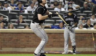 Colorado Rockies' Daniel Murphy watches his home run during the eighth inning of the team's baseball game against the Colorado Rockies on Friday, June 7, 2019, in New York. (AP Photo/Bill Kostroun)