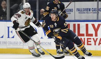 FILE - In this Feb. 10, 2019, file photo, Buffalo Sabres center Jeff Skinner (53) skates with the puck away from Chicago Blackhawks left wing Brandon Saad (20) during the first period of an NHL hockey game in Buffalo, N.Y. The Sabres have re-signed leading scorer Skinner to an eight year, $72 million contract. (AP Photo/Adrian Kraus, File)