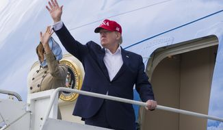 President Donald Trump, with first lady Melania Trump, waves as they depart Shannon Airport, Friday, June 7, 2019, in Shannon, Ireland. (AP Photo/Alex Brandon)