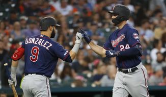 Minnesota Twins' C.J. Cron (24) celebrates his solo home run with Marwin Gonzalez (9) in the sixth inning of a baseball game against the Detroit Tigers in Detroit, Friday, June 7, 2019. (AP Photo/Paul Sancya)