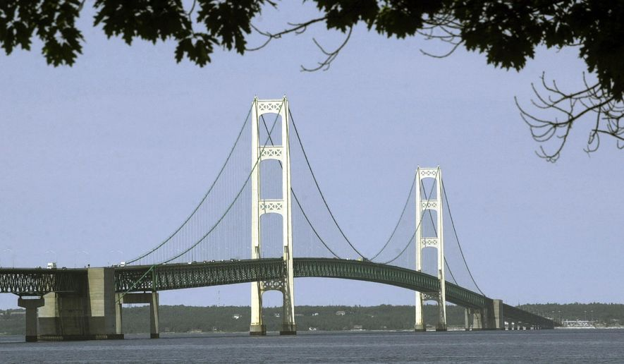 FILE - This July 19, 2002, file photo, shows the Mackinac Bridge that spans the Straits of Mackinac from Mackinaw City, Mich. Michigan Gov. Gretchen Whitmer is establishing a task force to assess energy needs in the state's Upper Peninsula. Among its top priorities will be finding a way to distribute propane across the far-flung region without utilizing Enbridge's Line 5 oil pipeline, the focus of a dispute between the Democratic governor and the Canadian company. Whitmer says the task force will examine alternatives to Line 5 fuels in addition to how the peninsula's overall energy needs are being met. (AP Photo/Carlos Osorio, File)